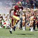 In this Sept. 14, 2014, file photo, Washington Redskins quarterback Robert Griffin III (10) runs on the field as he is introduced before an NFL football game against the Jacksonville Jaguars in Landover, Md. After six-plus games on the sideline, Robert Gr
