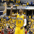 Paul George #24 of the Indiana Pacers celebrates as he walks to the bench during a timeout against the Atlanta Hawks during Game Seven of the Eastern Conference Quarterfinals of the 2014 NBA Playoffs on May 3, 2014 at Bankers Life Fieldhouse in Indianapolis, Indiana. The Pacers won 92-80. (Photo by Joe Robbins/Getty Images)