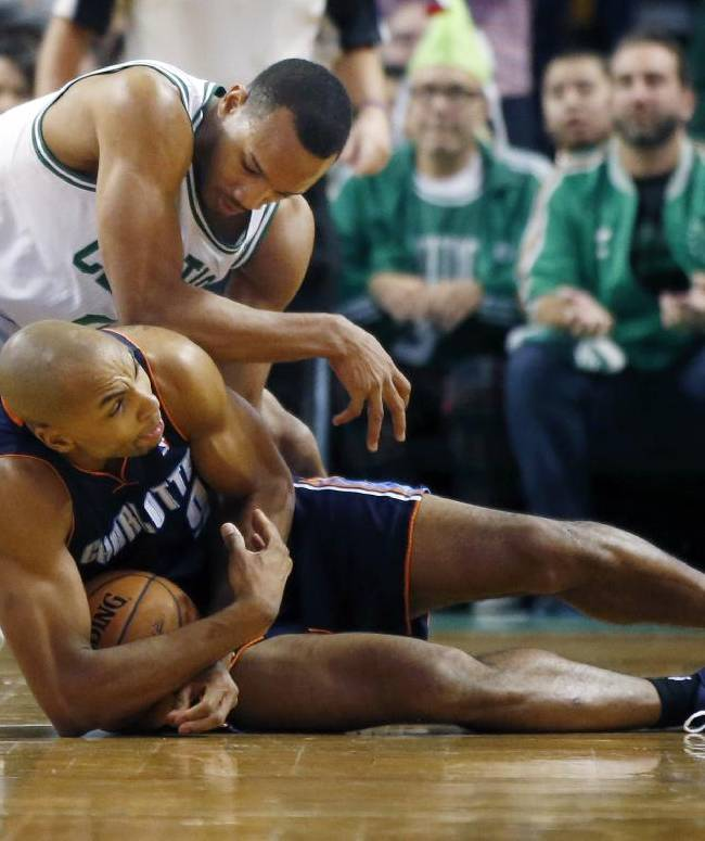 Charlotte Bobcats guard Gerald Henderson, below, protects the ball after stealing it from Boston Celtics point guard Avery Bradley in the fourth quarter of an NBA basketball game in Boston, Wednesday, Nov. 13, 2013. The Bobcats won 89-83