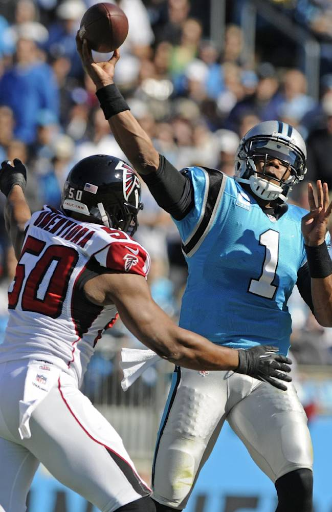 Carolina Panthers quarterback Cam Newton (1) throws a pass under pressure from Atlanta Falcons' Osi Umenyiora (50) in the first half of an NFL football game in Charlotte, N.C., Sunday, Nov. 3, 2013