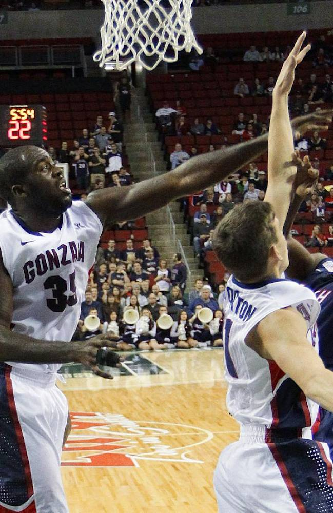 Gonzaga's Sam Dower (35) and David Stockton work to block a shot by South Alabama's Barrington Stevens III, right, in the second half of an NCAA college basketball game, Saturday, Dec. 14, 2013, in Seattle.  Gonzaga beat South Alabama 68-59