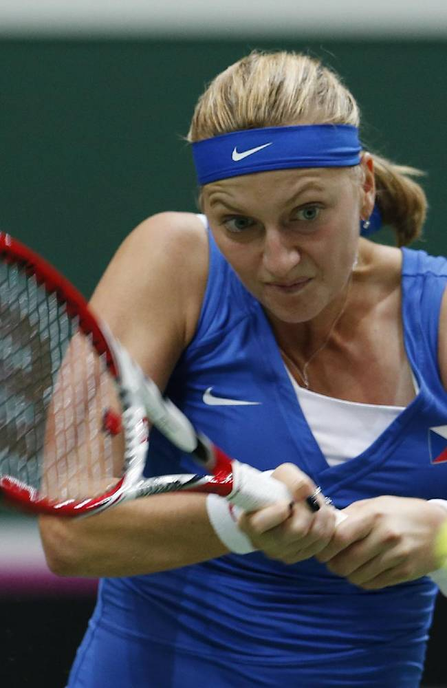 Czech Republic's Petra Kvitova returns a ball to Italy's Camila Giorgi during their Fed Cup semifinal tennis match in Ostrava, Czech Republic, Saturday, April 19, 2014