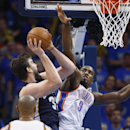 Memphis Grizzlies center Marc Gasol (33) shoots as Oklahoma City Thunder forward Serge Ibaka (9) defends during the fourth quarter of Game 1 of the opening-round NBA basketball playoff series in Oklahoma City on Saturday, April 19, 2014. Oklahoma City won