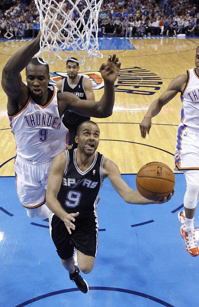 San Antonio Spurs guard Tony Parker (9) goes up for a shot in front of Oklahoma City Thunder forward Serge Ibaka (9) and guard Russell Westbrook (0) during the second quarter of an NBA basketball game in Oklahoma City, Thursday, April 3, 2014. Oklahoma City won 106-94