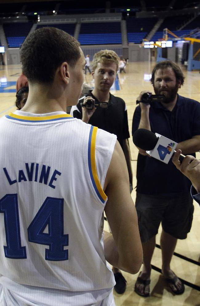 UCLA guard Zach LaVine (14) answers questions during the NCAA college basketball team's media day, Monday, Oct. 14, 2013, in Los Angeles