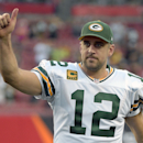 Green Bay Packers quarterback Aaron Rodgers (12) gives the thumbs up to fans as he leaves the field following the team's 20-3 win over the Tampa Bay Buccaneers during an NFL football game Sunday, Dec. 21, 2014, in Tampa, Fla. (AP Photo/Phelan M. Ebenhack)