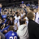 Drake players and fans celebrate on the court after their 74-69 win over Creighton in an NCAA college basketball game, Wednesday, Jan. 23, 2013, in Des Moines, Iowa. (AP Photo/Justin Hayworth)