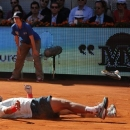 Rafael Nadal from Spain falls to the ground in celebration after winning the final of the Madrid Open tennis tournament against Stanislas Wawrinka from Switzerland, in Madrid Sunday, May 12, 2013.  (AP Photo/Andres Kudacki)
