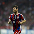 Bayern's Xabi Alonso reacts during the Champions League Group E soccer match between FC Bayern Munich and Manchester City at Allianz Arena in Munich, southern Germany, Wednesday Sept. 17, 2014