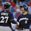In this April 8, 2014 file photo, Milwaukee Brewers' Ryan Braun (8) scores on his three-run home run and celebrates with Carlos Gomez in the eighth inning of a baseball game against the Philadelphia Phillies, in Philadelphia. They were labeled cheaters an
