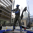 CORRECTS SPELLING OF LAST NAME TO BANKS, NOT BACKS - The statue of Chicago Cubs Hall of Famer Ernie Banks was placed next to the Picasso statue in Daley Plaza, as baseball fans get their first chance to pay their respects, Wednesday, Jan. 28, 2015, in Chicago. The city and the Cubs took the unprecedented step of taking the statue out of storage, where it was being held while the ballpark is renovated, and put it on public display away from its usual home at Wrigley Field. Banks died on Friday, Jan. 23, 2015. He was 83.(AP Photo/M. Spencer Green)