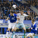 Everton's Gareth Barry, left, fights for the ball against West Ham United's Kevin Nolan during their English Premier League soccer match at Goodison Park Stadium, Liverpool, England, Saturday March 1, 2014