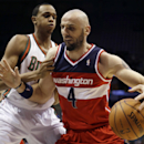 Washington Wizards' Marcin Gortat (4) tries to drive past Milwaukee Bucks' John Henson during the first half of an NBA basketball game Wednesday, Nov. 27, 2013, in Milwaukee The Associated Press