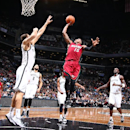 NEW YORK, NY - NOVEMBER 17: Mario Chalmers #15 of the Miami Heat shoots against the Brooklyn Nets on November 17, 2014 at the Barclays Center in the Brooklyn borough of New York City. (Photo by Nathaniel S. Butler/NBAE via Getty Images)
