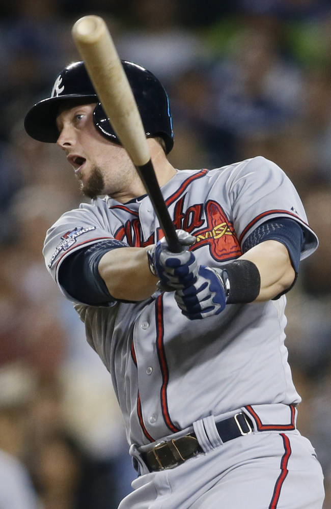 Atlanta Braves' Chris Johnson hits an RBI single to score Freddie Freeman in the fourth inning of Game 4 in the National League division baseball series, Monday, Oct. 7, 2013, in Los Angeles