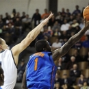Florida's Kenny Boynton (1) drives past Yale's Austin Morgan during the first half of an NCAA college basketball game in New Haven, Conn., Sunday, Jan. 6, 2013. Boynton matched his career high with 28 points as Florida won 79-58. (AP Photo/Fred Beckham)