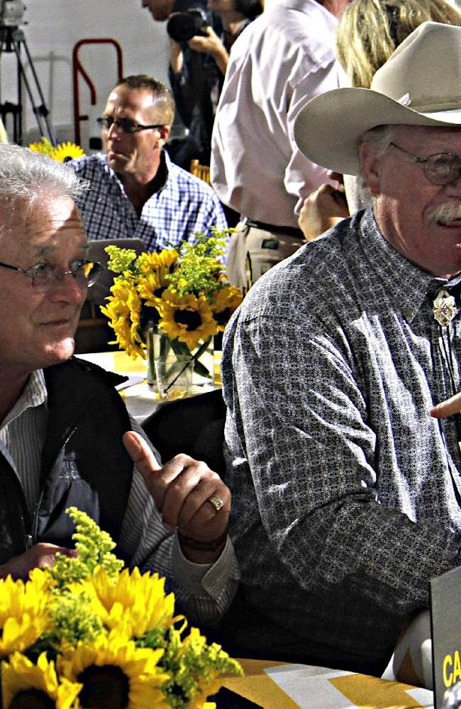 California Chrome trainer Art Sherman, left, and owner Steve Coburn, right, listen to a story before the start of the Preakness Stakes post position draw at Pimlico Race Course in Baltimore, Md., Wednesday, May 14, 2014