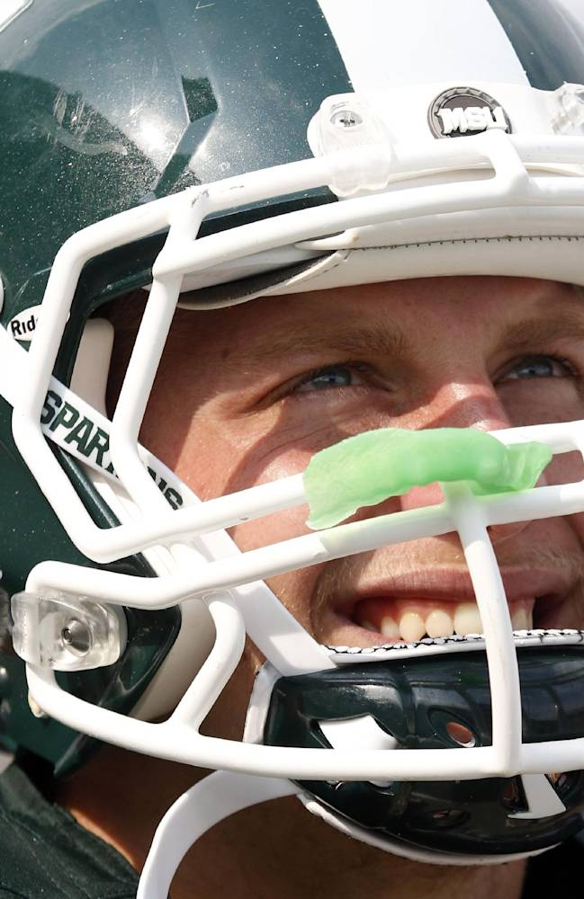 In this Sept. 7, 2013, file photo, Michigan State's Max Bullough watches from the sidelines during an NCAA college football game against South Florida in East Lansing, Mich. With a family history at Michigan State that stretches back decades, Bullough can provide a unique perspective on this week's showdown with rival Michigan