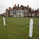 The clubhouse at Royal Liverpool Golf Club is seen before the British Open golf championships, Hoylake, England, Wednesday, April 23, 2014. The 2014 Open Championship which will be played at Royal Liverpool from July 17-20, 2014. (AP Photo/Jon Super)