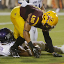 Arizona State running back D.J. Foster scores over Weber State safety Josh Burton during the first half of an NCAA college football game, Thursday, Aug. 28, 2014, in Tempe, Ariz The Associated Press
