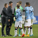 Manchester City's players talk to Referee Istvan Vad, second left, after the Group E Champions League soccer match between CSKA Moscow and Manchester City at Arena Khimki stadium in Moscow, Russia, Tuesday, Oct. 21, 2014. The match ended in a 2-2 draw