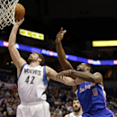 Minnesota Timberwolves forward Kevin Love (42) beats Los Angeles Clippers center DeAndre Jordan (6) to a rebound during the first quarter of an NBA basketball game in Minneapolis, Monday, March 31, 2014 The Associated Press