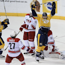 Nashville Predators center Paul Gaustad (28) and Eric Nystrom, left, celebrate after teammate Roman Josi (59), of Switzerland, not shown, scored the go-ahead goal in the third period of an NHL hockey game against the Carolina Hurricanes Tuesday, Jan. 6, 2