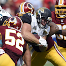 Jacksonville Jaguars running back Toby Gerhart (21) is tackled by Washington Redskins inside linebackers Keenan Robinson (52) and Perry Riley (56) during the second half of an NFL football game Sunday, Sept. 14, 2014, in Landover, Md The Associated Press