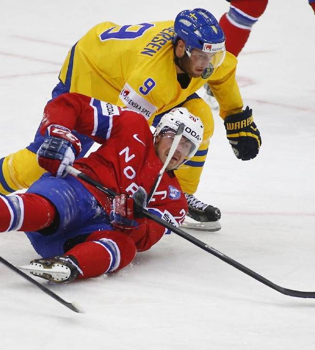 Norway's Anders Bastiansen, bottom, and Sweden's Niclas Andersen battle for the puck during the Group A preliminary round match at the Ice Hockey World Championship in Minsk, Belarus, Tuesday, May 13, 2014