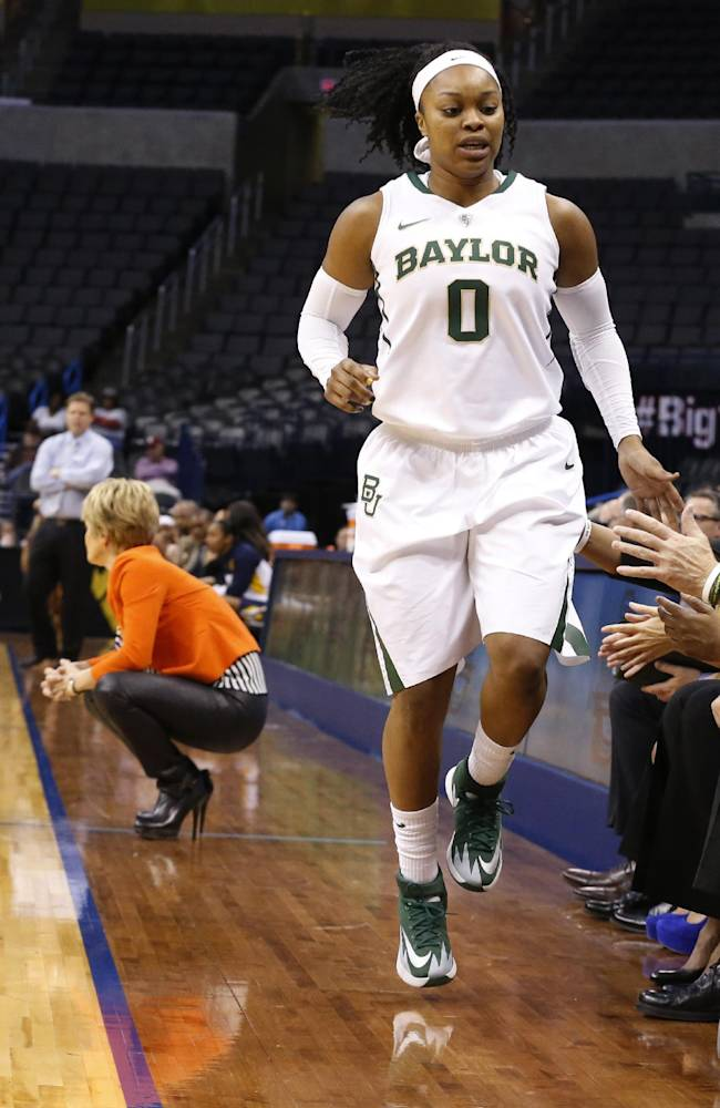 Baylor guard Odyssey Sims (0) hops off the court with an ankle injury in the first half of an NCAA college basketball game against West Virginia in the finals of the Big 12 Conference women's college tournament in Oklahoma City, Monday, March 10, 2014. Sims overcame the injury and scored 19 points as Baylor won 74-71