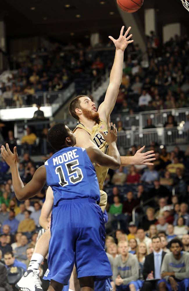 Notre Dame forward Garrick Sherman puts a shot up over Indiana State forward Demetrius Moore (15) during the first half of an NCAA college basketball game Sunday, Nov. 17, 2013, in South Bend, Ind