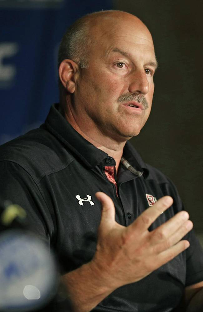 In this July 21, 2014, file photo, Boston College head coach Steve Addazio answers a question during a news conference at the Atlantic Coast Conference Football kickoff in Greensboro, N.C. Addazio, in his second year at the Boston College, looks to replace many key contributors from last year's team