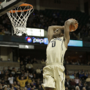 Wake Forest's Codi Miller-McIntyre (0) goes up to dunk against Duke during the first half of an NCAA college basketball game in Winston-Salem, N.C., Wednesday, March 5, 2014. (AP Photo/Chuck Burton)