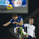 Everton's Philip Jagielka, left, fights for the ball against West Bromwich Albion's Craig Gardner during the English Premier League soccer match between Everton and West Bromwich Albion at Goodison Park Stadium, Liverpool, England, Monday Jan. 19, 2015