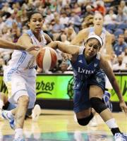 Minnesota Lynx forward Maya Moore, right battles for possession against Chicago Sky forward Tamera Young, left, during the first half of a WNBA basketball game, Saturday June 23, 2012, in Minneapolis. (AP Photo/ Genevieve Ross)