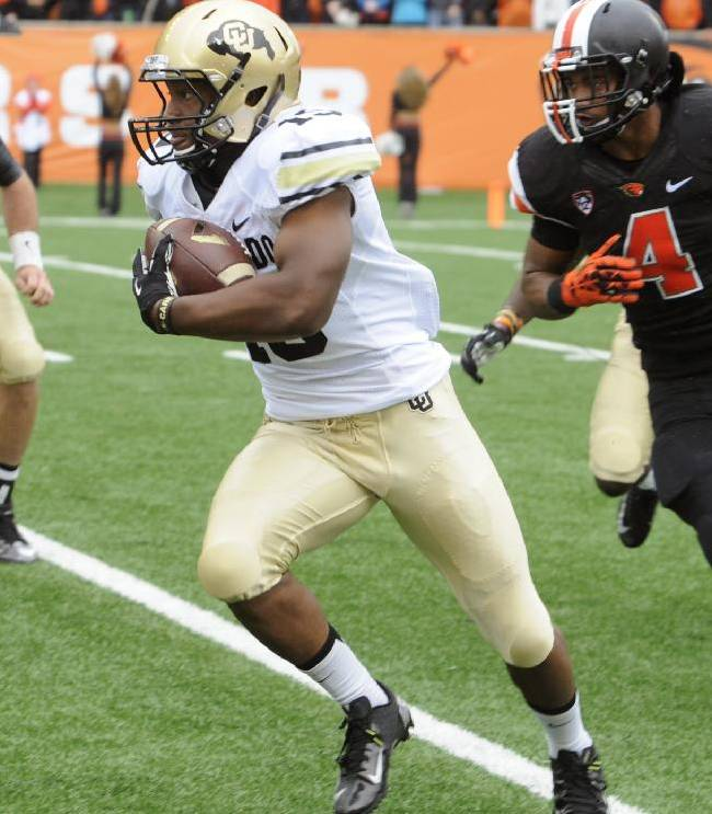 Oregon State's D.J. Alexander (4) chases Colorado's Michael Adkins (19) in the first half of an NCAA college football game on Saturday, Sept 28, 2013, in Corvallis, Ore