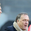Sunderland manager Dick Advocaat, left, looks on as player Adam Johnson waits to replace Jermain Defoe, right, during their English Premier League soccer match between Sunderland and Newcastle United at the Stadium of Light, Sunderland, England, Sunday Ap