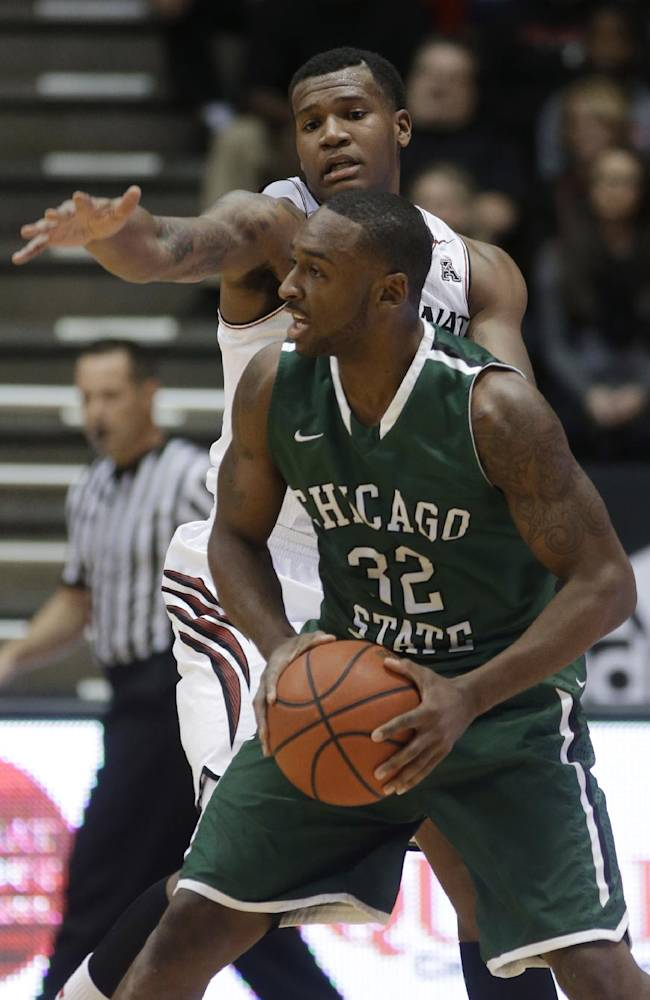 Chicago State guard Nate Duhon (32) looks to pass the ball away from Cincinnati forward Jermaine Sanders during the first half of an NCAA college basketball game, Monday, Dec. 23, 2013, in Cincinnati