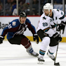 San Jose Sharks defenseman Dan Boyle, front, picks up a loose puck as Colorado Avalanche left wing Cody McLeod covers in the third period of the Avalanche's 3-2 victory in an NHL hockey game in Denver on Saturday, March 29, 2014 The Associated Press