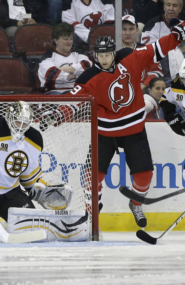 Boston Bruins goalie Chad Johnson (30) blocks a shot by New Jersey Devils' Patrik Elias (26) during the first period of an NHL hockey game in Newark, N.J., Sunday, April 13, 2014