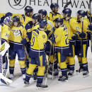 Nashville Predators goalie Pekka Rinne (35), of Finland, is congratulated after stopping all the shots in a shootout against the Los Angeles Kings at an NHL hockey game Tuesday, Nov. 25, 2014, in Nashville, Tenn. The Predators won the shootout to win the game 4-3. (AP Photo/Mark Humphrey)