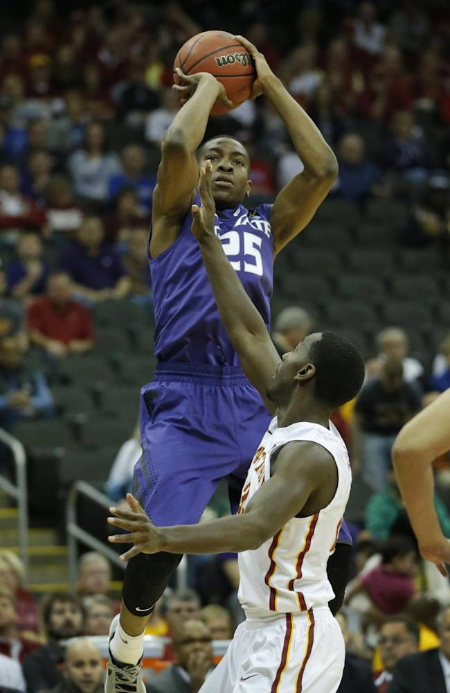 Kansas State guard Wesley Iwundu (25) shoots over Iowa State forward Dustin Hogue (22) during the first half during the first half of an NCAA college basketball game in the quarterfinals of the Big 12 Conference men's tournament in Kansas City, Mo., Thursday, March 13, 2014