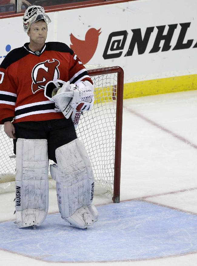 New Jersey Devils goalie Martin Brodeur stands in goal late in the third period of an NHL hockey game against the Boston Bruins in Newark, N.J., Sunday, April 13, 2014. The Devils won 3-2
