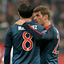 Bayern's Thomas Mueller, right, comforts his teammate Javier Martinez, left, after the Champions League group D soccer match between FC Bayern Munich and Manchester City, in Munich, southern Germany, Tuesday, Dec. 10, 2013. Manchester defeated Munich by 3