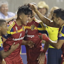 Real Salt Lake's Carlos Salcedo, second from left, celebrates with teammates Joao Plata, left, and Javier Morales (11) after scoring against the Colorado Rapids in the second half of an MLS soccer game Friday, Sept. 19, 2014, in Sandy, Utah. Real Salt Lak