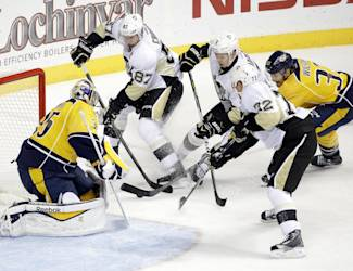 Pittsburgh Penguins center Sidney Crosby (87) scores a goal against Nashville Predators goalie Pekka Rinne (35), of Finland, in the first period of an NHL hockey game Saturday, Oct. 25, 2014, in Nashville, Tenn. (AP Photo/Mark Humphrey)