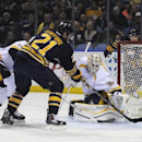 Buffalo Sabres right winger Drew Stafford (21) pushes the puck past Nashville Predators goaltender Carter Hutton (30) for a goal during the first period of an NHL hockey game, Tuesday, March 11, 2014, in Buffalo, N.Y The Associated Press