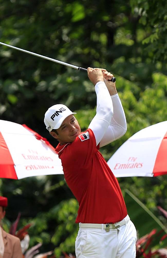 Julien Quesne of France tees off on the eighth hole during the third round of the Malaysian Open golf tournament at Kuala Lumpur Golf and Country Club in Kuala Lumpur, Malaysia, Saturday, April 19, 2014