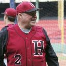 In this April 9, 2012 photo released by Harvard University, head baseball coach Joe Walsh smiles during his team's batting practice in Fenway Park in Boston, as part of the 100 year anniversary of the ballpark. Walsh, who won five Ivy League championships in his 17 years with the Crimson, died at his Chester, N.H., home Tuesday, July 31, 2012. He was 58. (AP Photo/Harvard University)