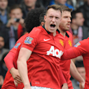 Manchester United's Phil Jones celebrates after scoring against West Brom during the English Premier League soccer match between West Bromwich Albion and Manchester United at The Hawthorns Stadium in West Bromwich, England, Saturday, March 8, 2014